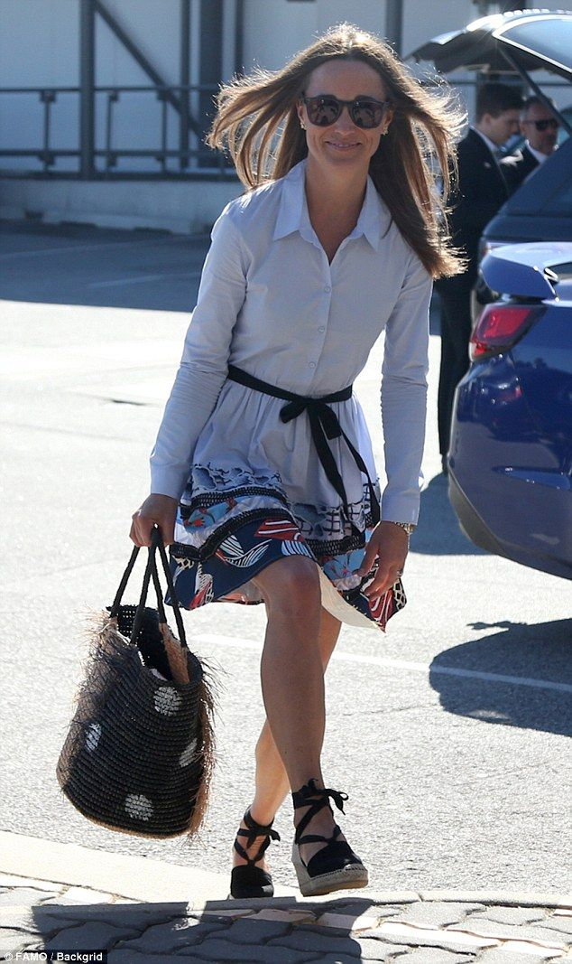 Pippa's hair billowed in the wind as she stepped into Perth airport on Monday, smiling as she passed waiting cameras