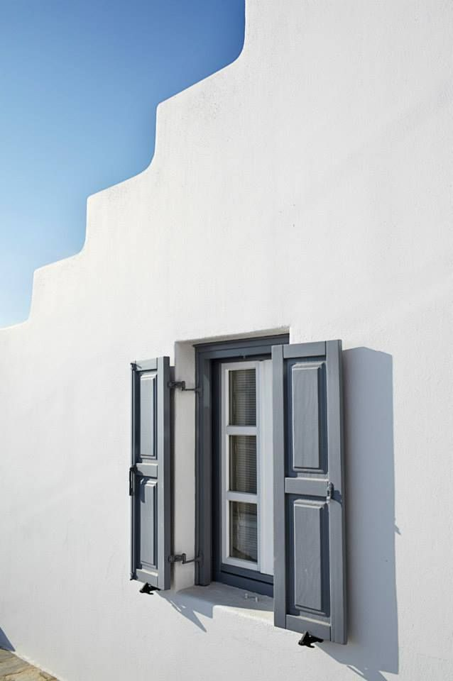 wooden window with shutter in Mykonos, Greece by VI.E.K.KO. S.A.