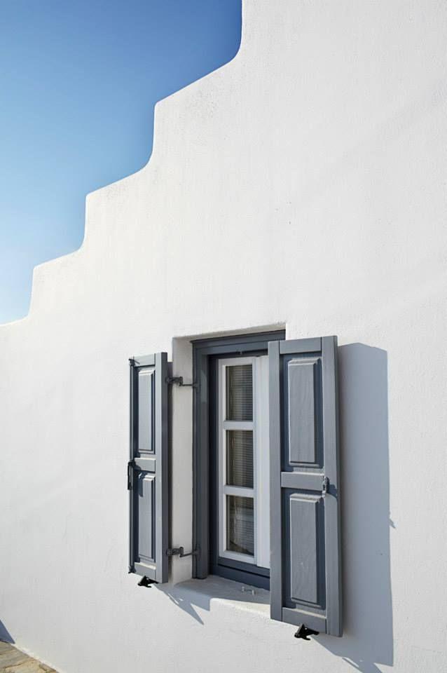 wooden window with shutter in Mykonos, Greece by VI.E.K.KO. S.A.