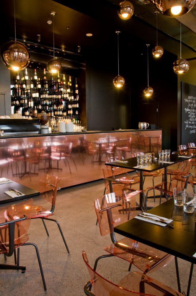 Baroque Bar Bistro Patisserie, low lighting, dark table tops, huge copper bar, clear plastic seats