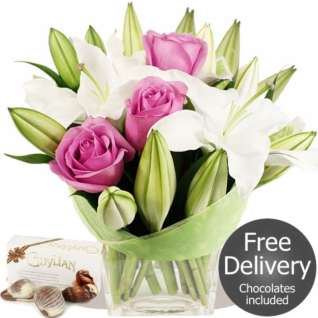 Rhapsody & FREE Chocolates  A stylish bouquet and sure to delight. This florist arranged beauty is made to order by our florists and sure to delight everytime. Includes white Oriental Lilies and pink Roses #wedding #flowers