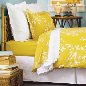 I like the idea of yellow bedding in a turquoise room!!