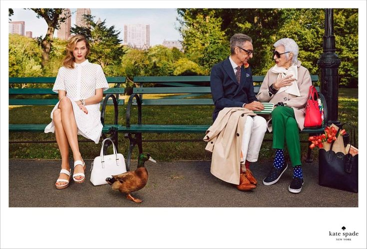 Top model Karlie Kloss and 93-year-old fashion icon Iris Apfel are the two stars of Kate Spade's spring-summer 2015 campaign. The images were shot by Emma Summerton and feature the duo posing in a park while joined by a colorful cast including a duck and two adorable redhead twins. Spade's accessories are front and center as well as new season clothing.