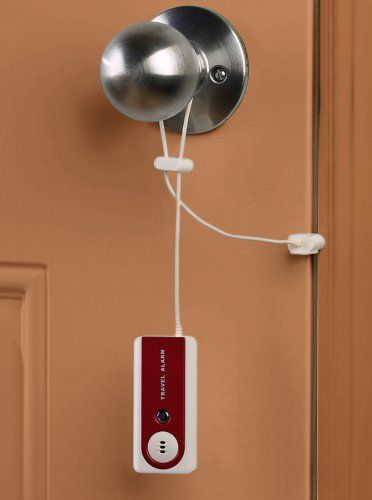 For the sketchier hostels and hotels. Amazon.com: Belle Hop Travel Door Alarm with LED Flashlight, Red: Clothing