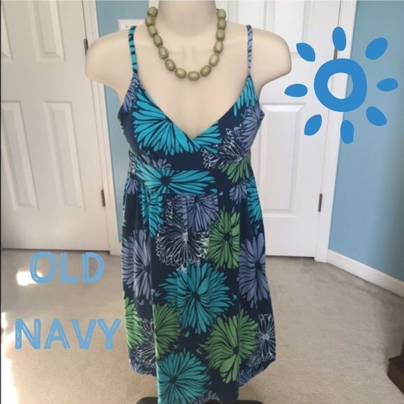 Dress$10 or 2 for $15 Navy dress with big and bold flowers in green, blue and grey! Just in time for summer  ⭐️ items marked with a  are 2 for $15! Let me know what two items you would like to purchase and I will create a new listing ⭐️ Old Navy Dresses