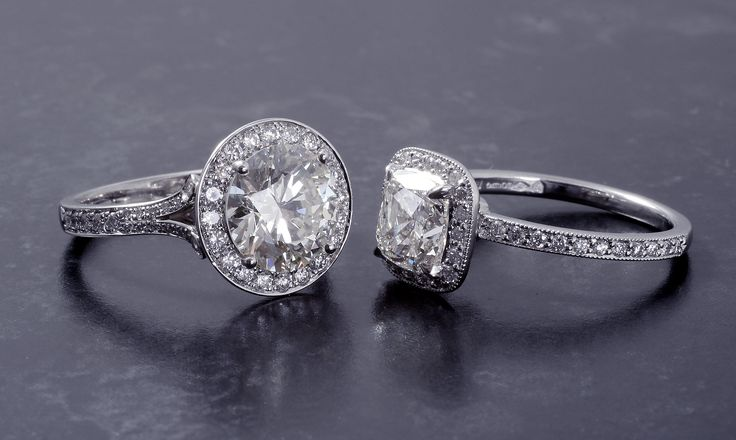 Platinum & Diamond Halo Cluster Ring's. 1.50ct & 2.32ct central diamonds, one cushion cut diamond, four claw set with grain set with 44 modern round brilliant diamonds with a combined weight of 0.25ct. Crafted as a 'one-off' using CAD/CAM technologies. The other a Brilliant cut diamond, 2.32ct, M colour, SI2 clarity, HRD certificated stone. The surrounding bezels, under bezels and shoulders are grain set with 62 round brilliant cut diamonds, 0.64ct total. Hallmarked, including Chichester…