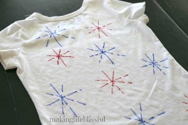 How to make 5 minute tie dye shirts using a Sharpie marker.  Cute and easy DIY 4th of July t-shirts are so patriotic and an easy 4th of July craft for kids to make!