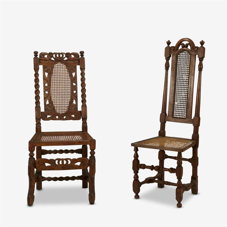 Two William & Mary style carved oak caned side chairs  after Daniel Marot  19th century, with some earlier elements  The first with shaped crestrail above caned splat and two turned stiles over square caned seat, raised on turned legs united by turned stretchers; the second with crestrail carved with putti holding aloft a crown above similarly carved caned splat and two barley twist stiles over square caned seat
