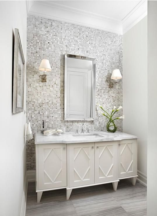 White And Gray Bathroom Features A Gray Mosaic Tiled Accent Wall Lined With A White Washstand