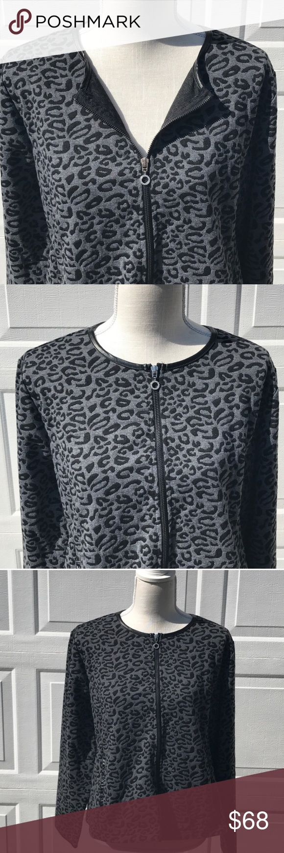 Cathy Daniels C.D. Petite animal print jacket PXL Cathy Daniels C.D. Petite animal print jacket PXL  Item: Cathy Daniels C.D. Petite animal print jacket PXL Color: black and white  Style: animal print leather collar zip up light weight jacket  Size: Petite XL Excellent used condition!    **Please see all photos. Feel free to ask any questions before purchase** Cathy Daniels Sweaters Cardigans
