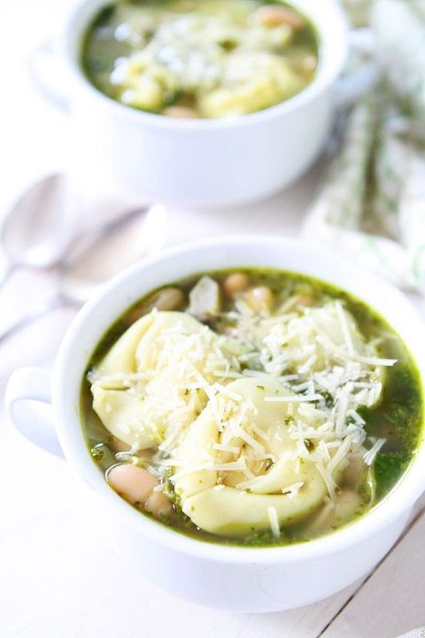 Spinach Artichoke Pesto Tortellini Soup Recipe on twopeasandtheirpod.com Love this simple soup recipe! #soup #vegetarian