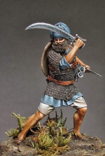 Figure by Sergey Popovichenko  Akali Sikh warrior. India, XVIII-XIX centuries. Manufacturer Chronos Miniatures. 54mm, resin. Figure painted with acrylic and oil paints. Painting made for a private collection. Photos will be used by the manufacturer.