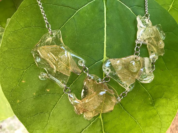 Recycled necklace with natural beige leaf  https://www.etsy.com/it/listing/257846763/recycled-necklace-with-natural-beige?ref=shop_home_active_30  Made In Slovenia, conscious Living, evening necklace, urban necklace, unusual necklace, recycle necklace, plastic jewelry, handmade, contemporary jewelry, statement jewelry, plastic jewellery, plastic necklace, eco jewellry, vegan, wedding necklace big necklace, crafts, eco necklace, nature necklace, leaf necklace, eco friendly, assymetrical…
