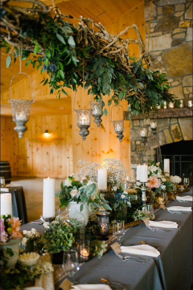 hang a reclaimed wood board above your dinning table.... you can seasonally decorate it for dinner with branches, vines, lanterns, or candles