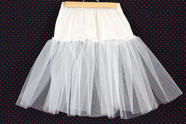 "To give your skirts and dresses some ""Rockabilly"" dimension, sew a tulle crinoline using a slip and tulle to wear underneath."
