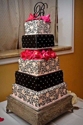 Black and Pink Swirly Cake...Switch out pink petals for red and make it a Black and White cake.