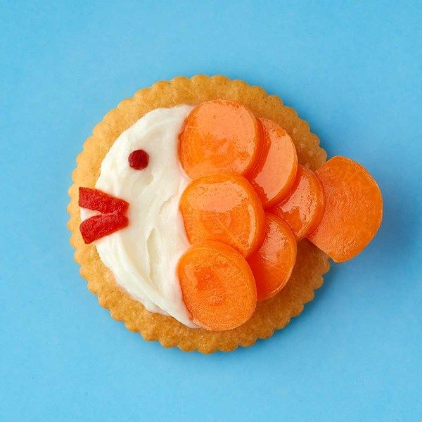 "RITZ Cream Cheese & Veggie Swimmers | ""Baby carrot slices create the fish scales, and pieces of pimento make the eyes and mouths of these 'gold fish' bites."""