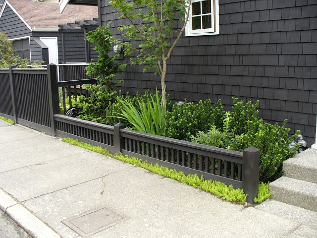 Lovely fence of varying heights, tied together by the dark grey colour