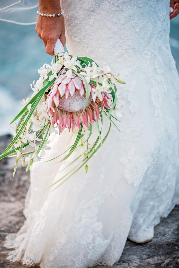 Beach bride, wedding bouquet, king protea, palm fronds, white flowers // Mariah Milan