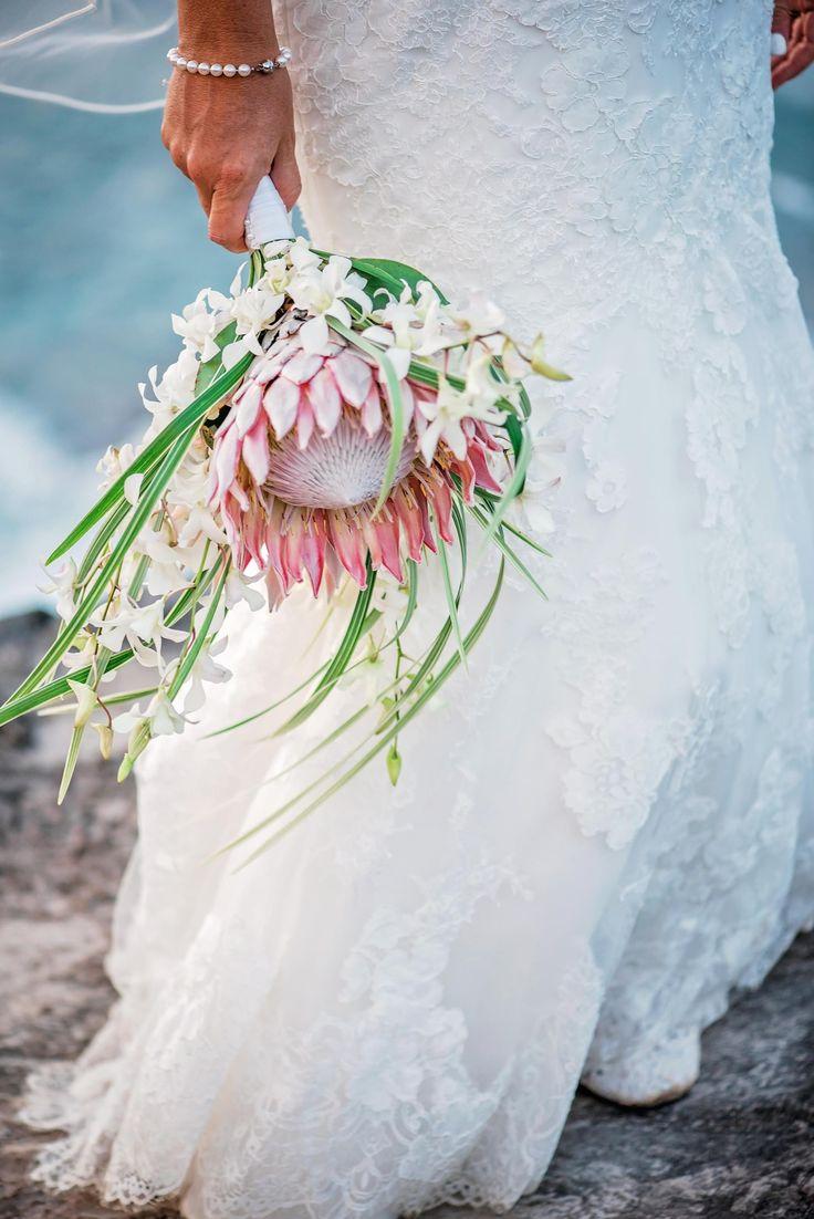 Beach bride, wedding bouquet, king protea, palm fronds, white flowers // Mariah Milan