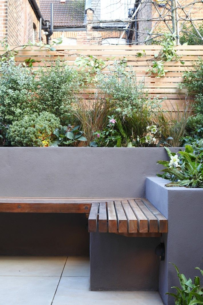 #modern #patio with #wood_fence #concrete_and_concrete_benches and #raised_flower_bed