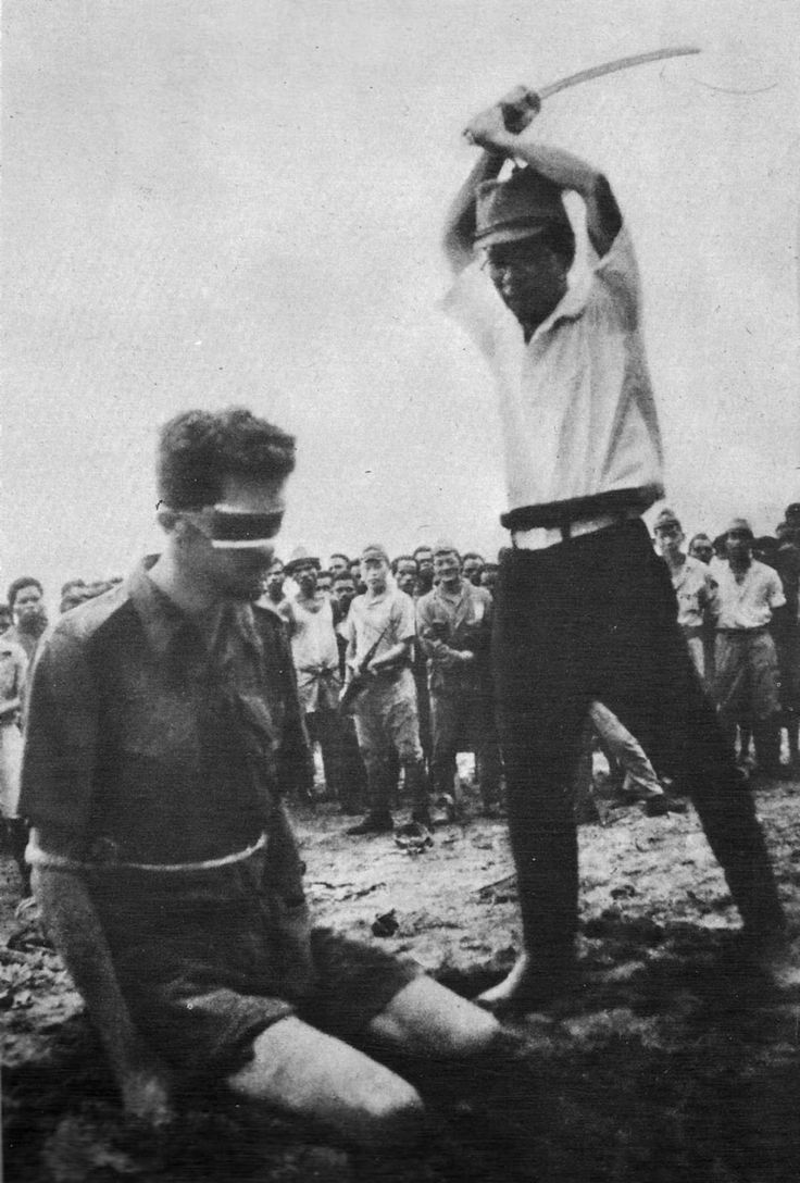 A photograph of the Japanese soldier Yasuno Chikao an instant before he strikes off Siffleet's head was taken from the body of a Japanese casualty later in the war, 1943.
