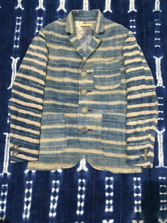 From Japanese cult brand Visvim, men's jacket tailored from faded Burkinabe indigo cloths…