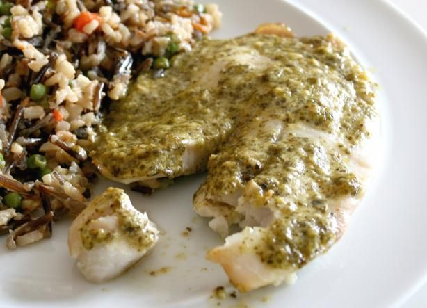 Simple and Quick Tilapia Pesto from Food.com:   I used to make this dish with fresh herbs, using whatever i had in the fridge, till the day came when i had no fresh herbs but i did have homemade pesto.