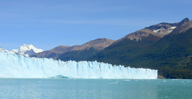 L1M1AS3   Nikon D7000 18-142mm auto( no flash).  February 2016 trip to Patagonia; Puerto Moreno Glacier near Calafete,  Argentina. Lucky to have clear calm late summers day.  I hoped to get the stark blue/white of the glacial wall contrasted with the water with that white snow capped mountain off in the distance.