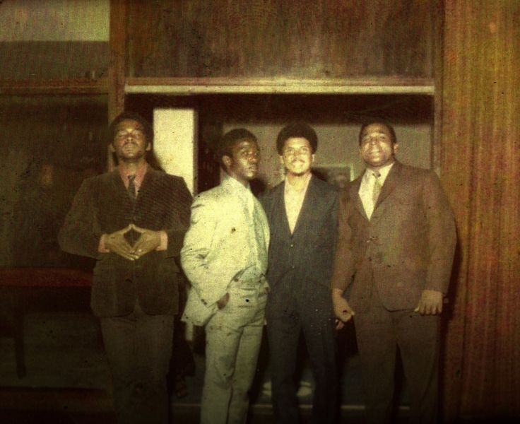 Entertainers JOHN HOLT, DELROY WILSON and DENNIS ALCAPONE with producer BUNNY LEE...