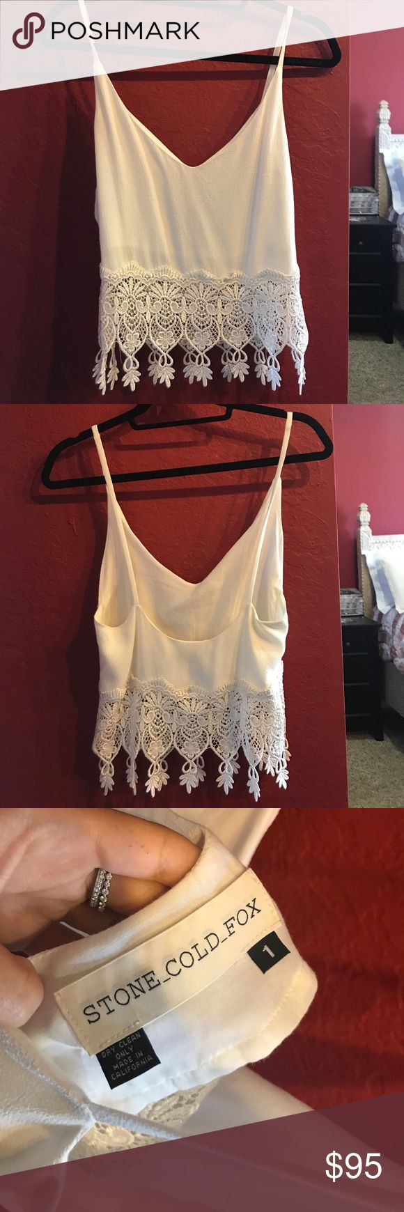 Stone cold fox lace shirt with low back Stone cold fox shirt with v neck front and thin straps with low back. Signature stone cold fox lace details all around the bottom. Not crop top but shows a bit of skin at the bottom. Size 1, worn once only, in perfect condition Stone Cold Fox Tops Camisoles