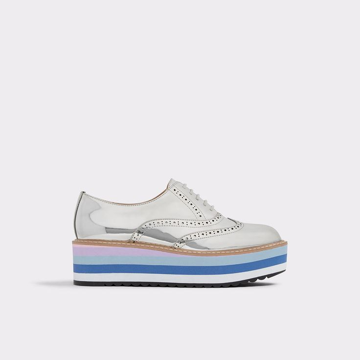 Wadolia This borrowed-from-the boys brogue shoe set on a platform striped sole has all the makings for a standout finish to any outfit.