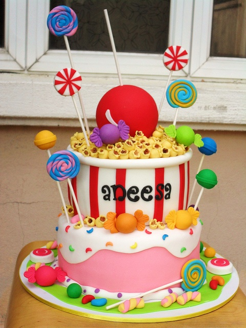 Party #Cake With Candy Canes & Giant Lolly! We love and had to share! Such a fun cake! Great #CakeDecorating