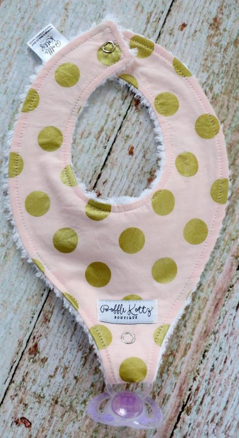 Such a cute baby bib for all the littles out there. This super trendy pink and gold polka dot bib would make a great stocking stuffer. This binky bib would also make a great baby shower gift for that