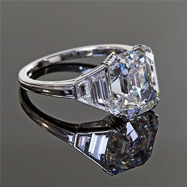 Antique Five Carat Asscher Cut Diamond Ring in Platinum. Oh my God.