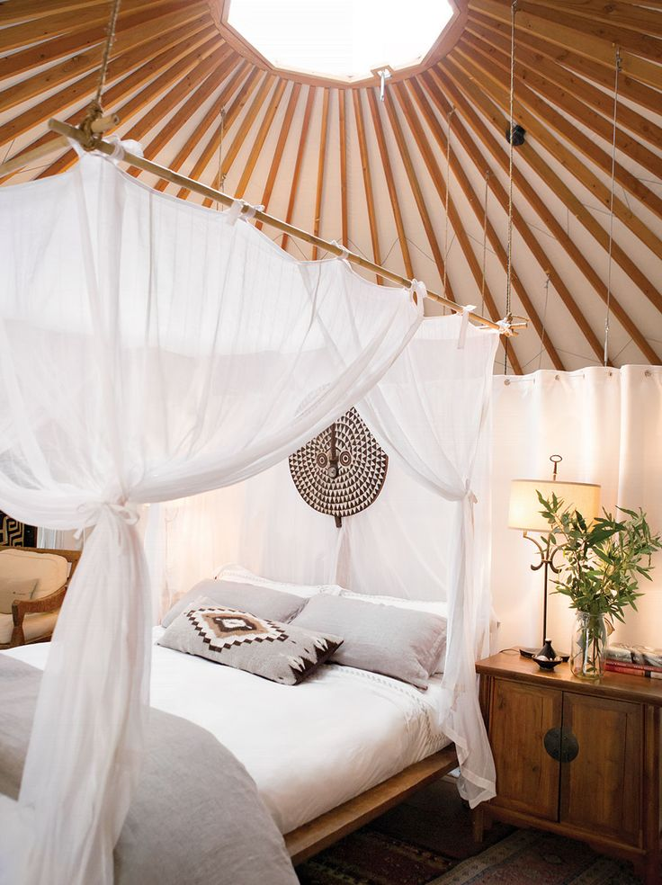 Stacey Twilley hung an African tribal shield above the bed in one of the guest yurts.