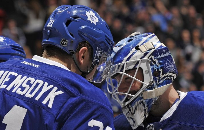 TORONTO, ON - FEBRUARY 21: James van Riemsdyk #21 and Jonathan Bernier #45 of the Toronto Maple Leafs celebrate the teams win over the Winnipeg Jets during NHL game action February 21, 2015 at the Air Canada Centre in Toronto, Ontario, Canada. (Photo by Graig Abel/NHLI via Getty Images)