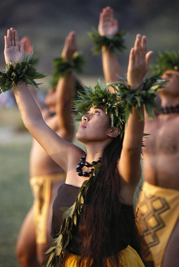 Side Angle Of Hula Dancers, All With Arms Raised, Looking Upward