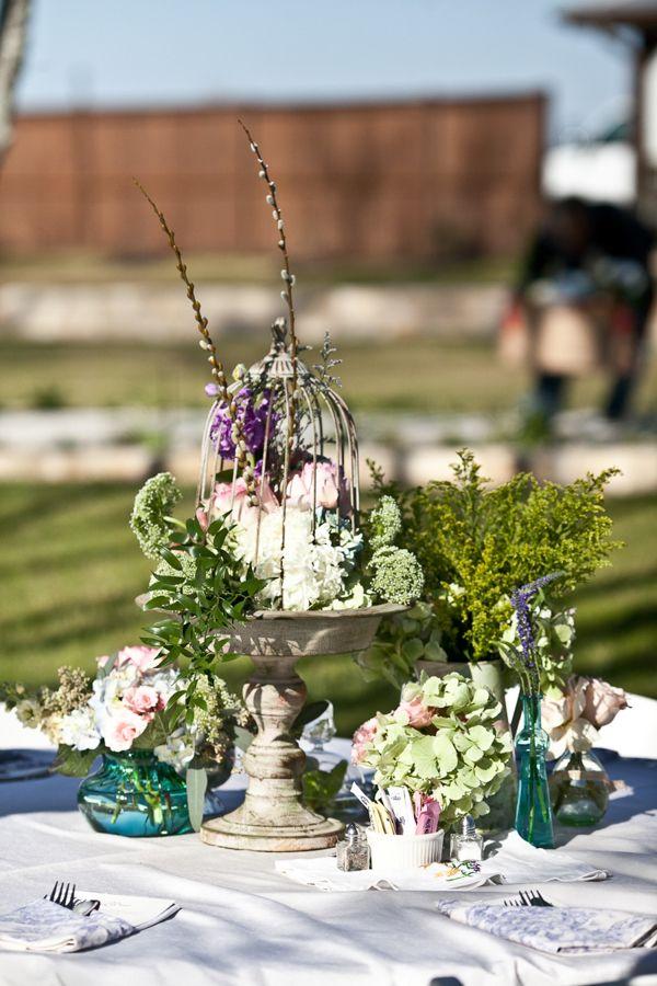 purple and green centerpiece idea http://www.weddingchicks.com/2013/09/18/eclectic-spring-wedding/
