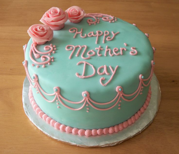 Pink & Blue Mother's Day Cake - Strawberry cake with vanilla buttercream, covered in fondant.  Roses are fondant/gumpaste.