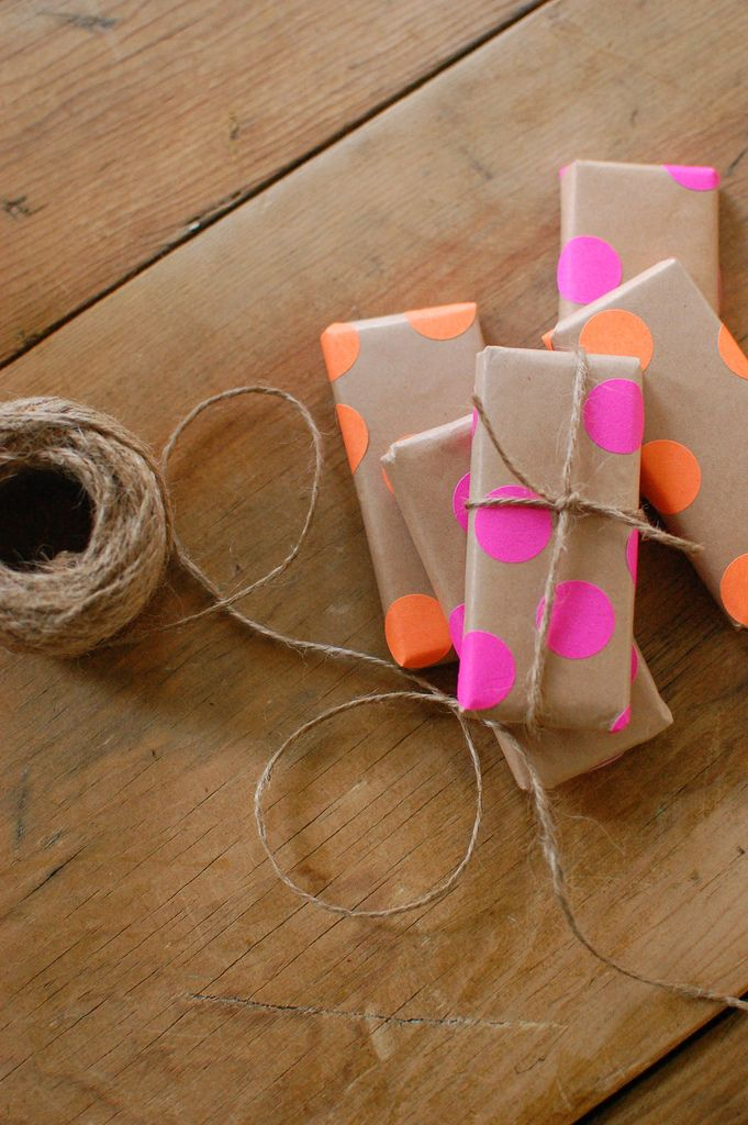 adorable DIY wrapping paper- cut an old brown grocery or take out bag, cut it into a sheet and wrap a gift in it. Take those sticker dots from the office supply store and polka dot the wrapped gift, add twine for a bow with a rustic touch. So cute!