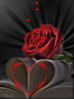 Imagen de amor de corazones y rosas con brillo y movimiento corazones volando