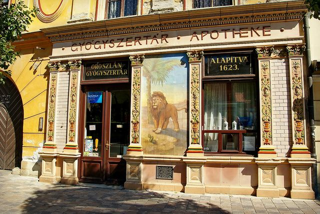 In the town of Sopron, near the Austrian Border, you will find the gorgeous old decorated frontage of the Golden Lion Pharmacy. The designs were prepared by the Zsolnay porcelain works in 1880 (actually to replace the previously destroyed 17th century Golden Eagle building on the same spot!)