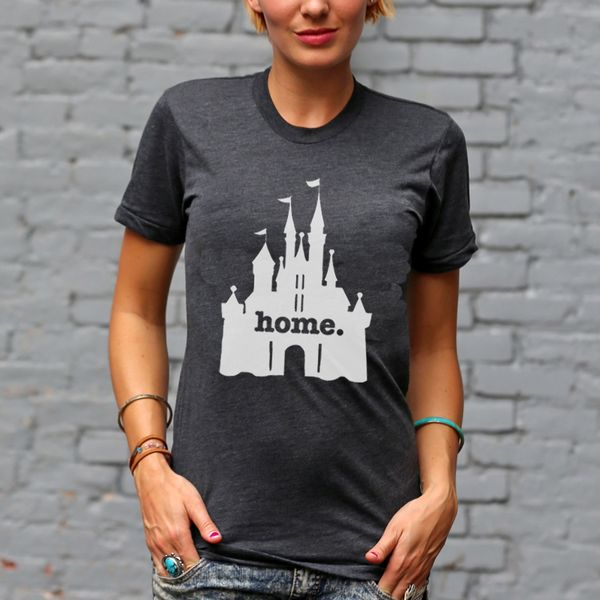 "Is there a certain ""magical"" place that feels like home to you? Then our limited edition Home at the Castle shirt has your name all over it."