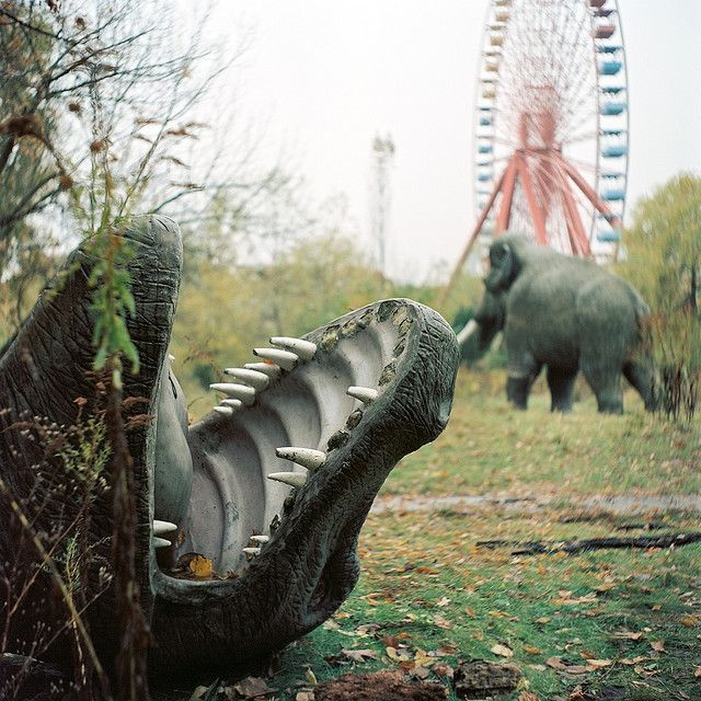 """Abandoned Spreepark, Berlin.  From 1969 to 1989, Cultural Park Plänterwald was East Germany's premiere amusement park. Later rechristened """"Spreepark,"""" it eventually closed in 2002, after the park's operator picked up and left for Peru .  He and his son were later arrested for trying to smuggle 167 kilograms of cocaine back to Germany inside the """"Flying Carpet"""" carousel.  Recently released from prison, the owner is thought to live somewhere within the park's mysterious grounds."""