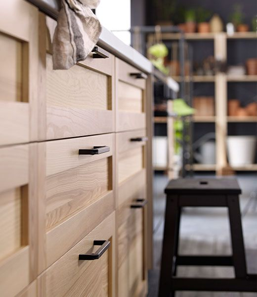 Simple timber kitchen cabinets. These ones are Ikea.