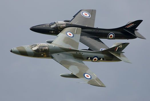 A pair of Hawker Hunter T7s (G-BXFI/WV372 and G-FFOX/WV318) in a close formation fly past at the 2004 Kemble Air Day