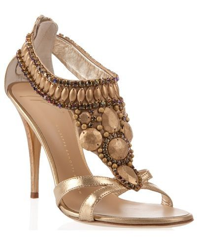 c9bbaba7529 Gold leather high-heel sandals rom Giuseppe Zanotti Design. The sandals are  embellished with bronze colour crystals and beads. The sandals have an open  toe