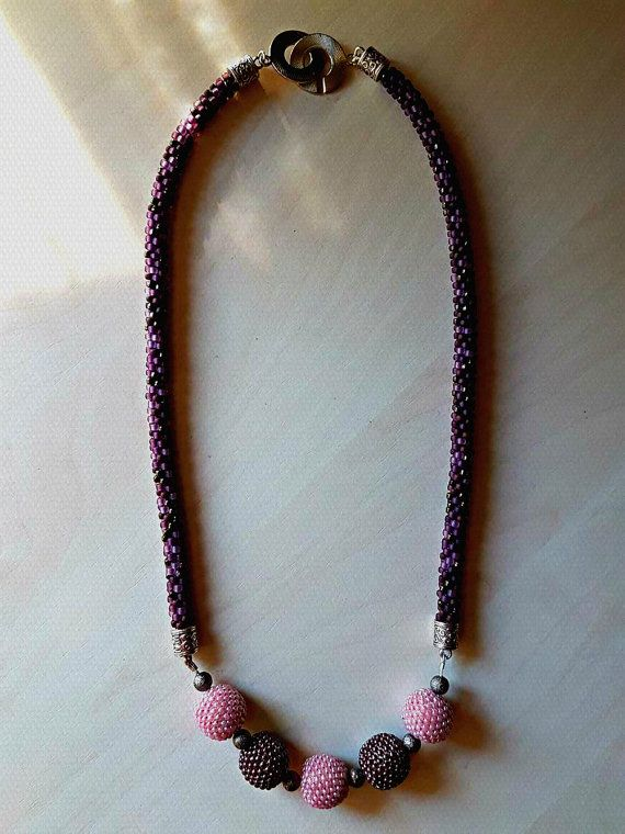 Kumihimo necklace made from toho beads. The middle section is also handmade. The wood beads are beaded with 11/0 toho beads.  **NOTE** The color might be slightly different than the photo. Colors may vary from monitor to monitor due to individual settings and limitations in digital photography. Every effort is made to come as close as possible to actual colors in each item.