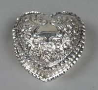 "Lot No 679 A Victorian repousse silver heart shaped dish decorated with scrolls, birds and fruit, London 1888, 4"", sold £160"